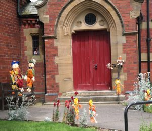 Colourful scarecrows and sunflowers outside the Methodist Chapel.