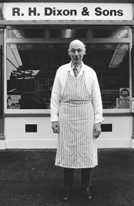 Mr. Geoff Dixon outside the butcher's shop in Main Street, Bishopthorpe. Photographed in 2000 by Roger Poyser.
